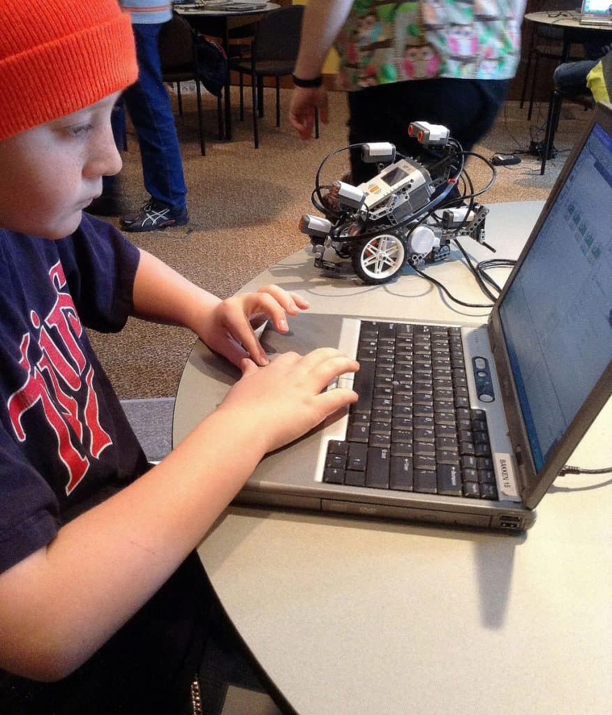 Child programming a robot