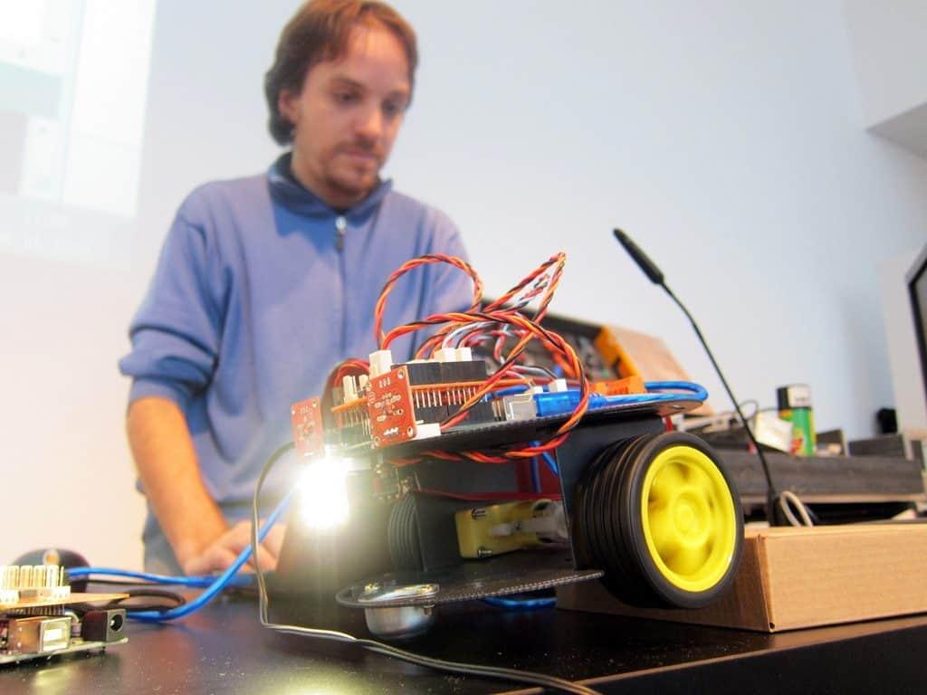 Man making a robot