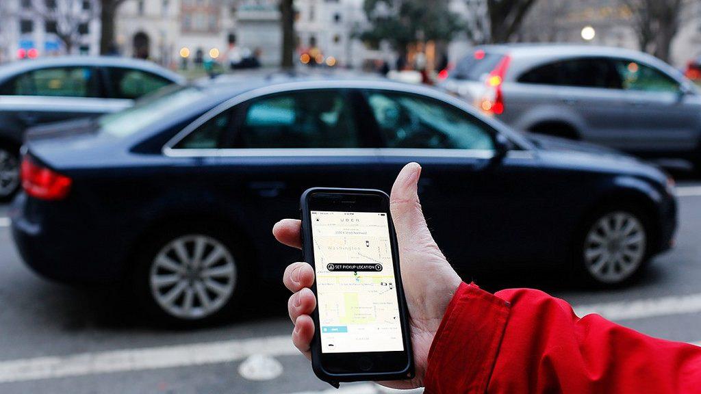 Handheld device displaying Uber app