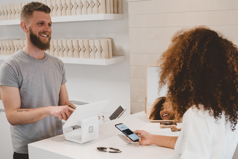 shop assistant serving customer